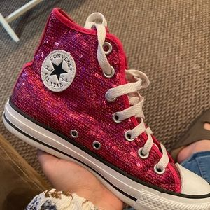 Hot pink high top converse
